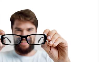 Man holding up glasses