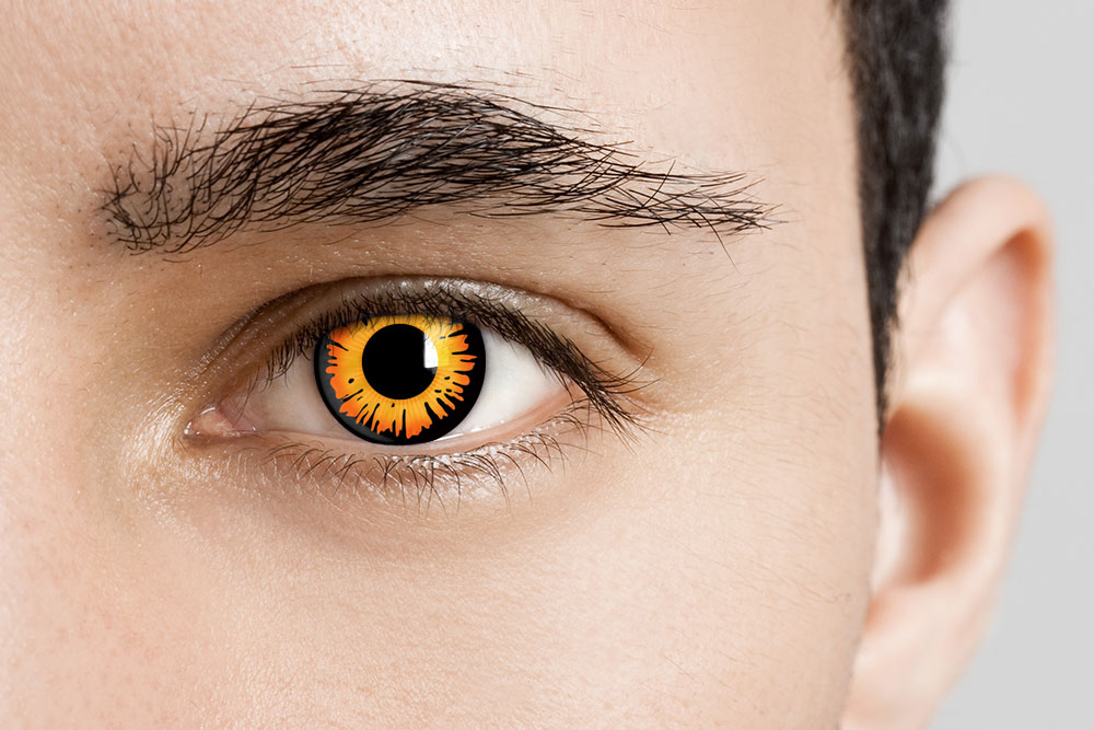 man wearing orange and black contacts