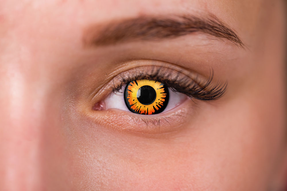woman wearing orange and black contacts