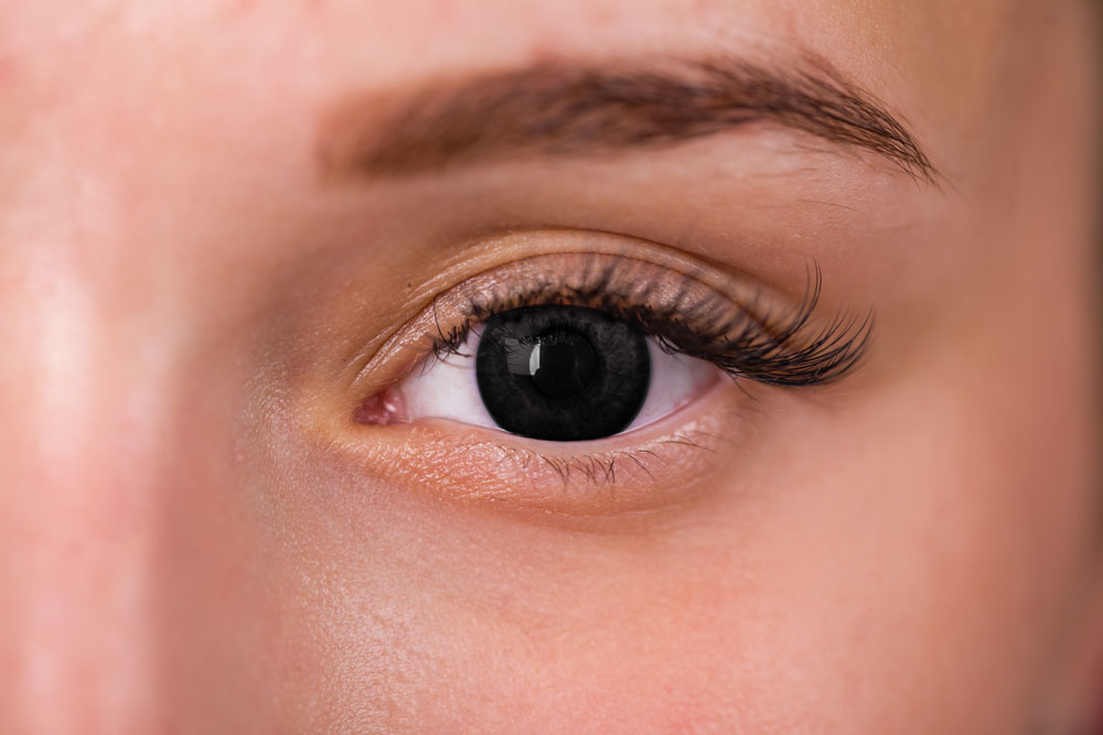 woman wearing all black eye contacts