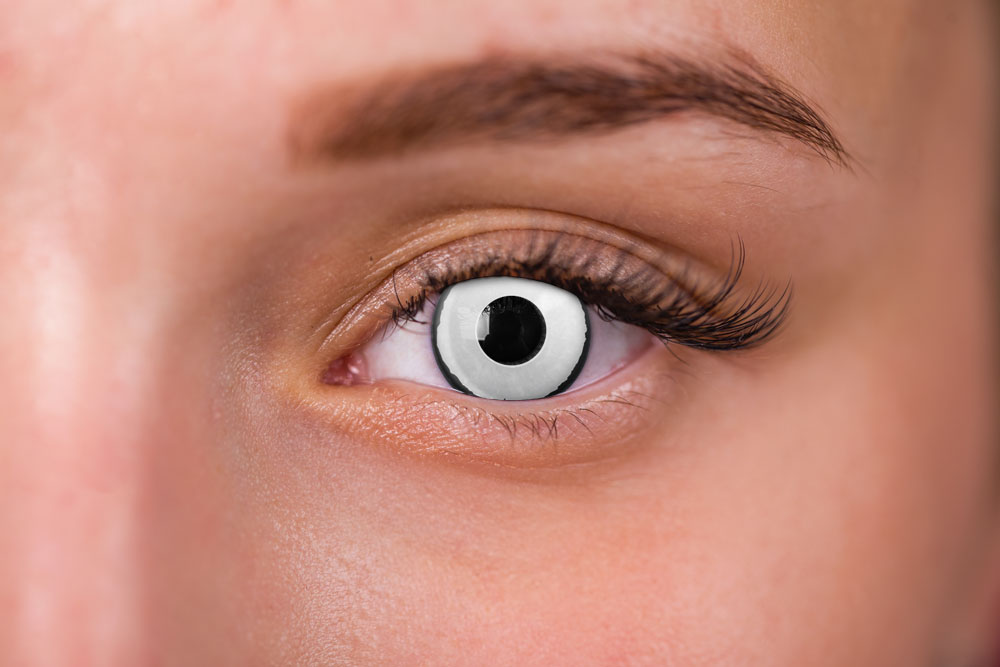 woman wearing white and black gargoyle contacts