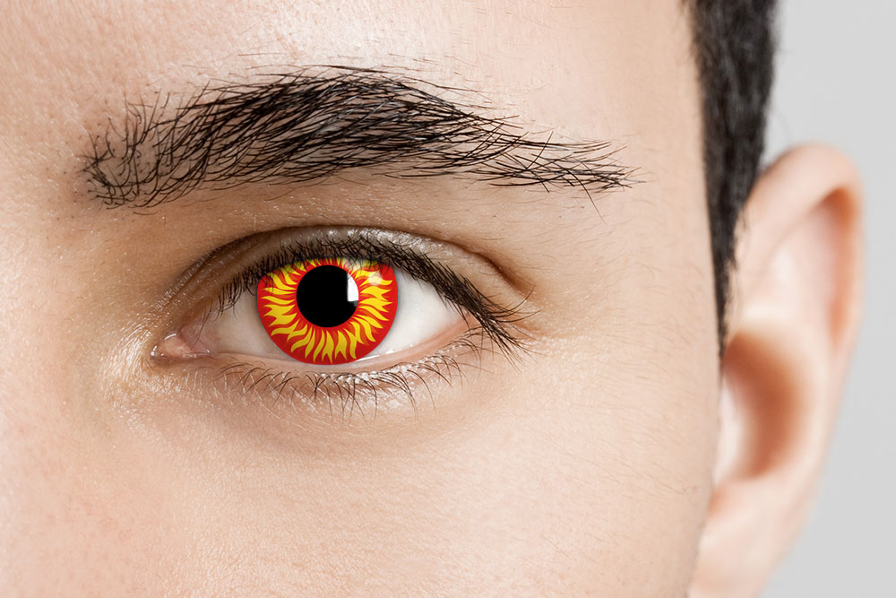 man wearing red and yellow fire contacts
