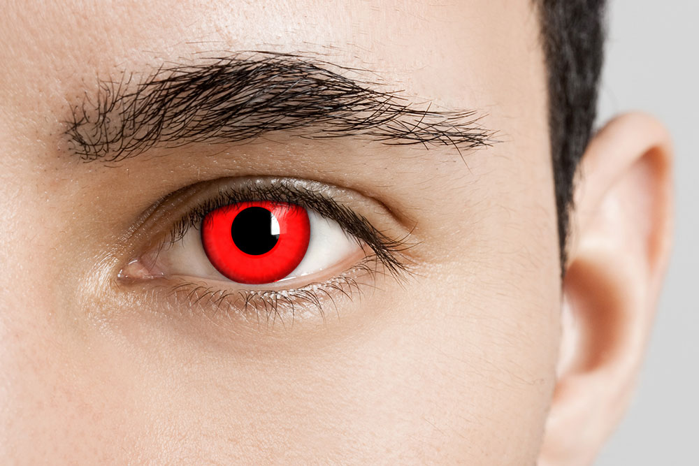 man wearing red vampire contact lenses