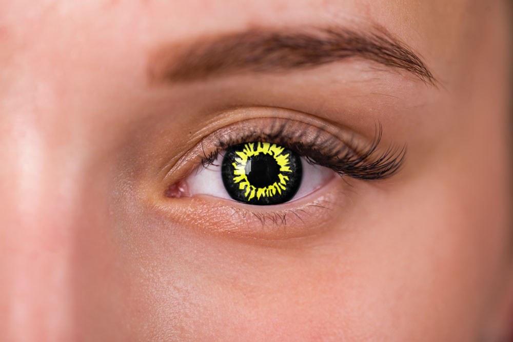 woman wearing yellow and black wolf contacts