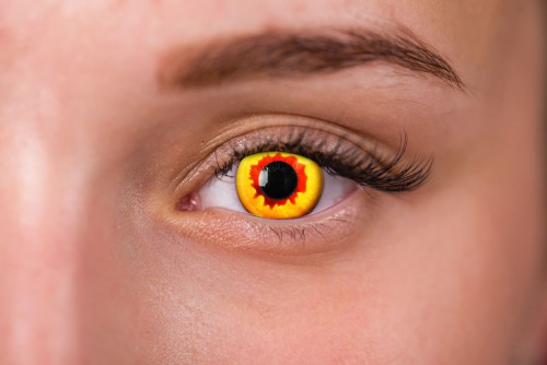 woman wearing red and yellow pennywise contacts